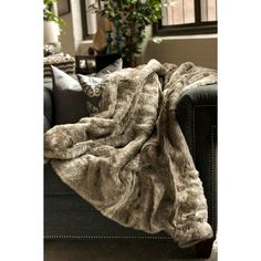 The Koala faux fur throw is not only a stylish accent piece with its luxurious velvet-like appeal, but it is also a functional item with its polyester-acrylic blend that keeps you warm on chilly nights.