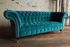 Introducing our 3 Seater Blue Teal Velvet Chesterfield Sofa. This 3 seater Chesterfield Sofa consists of a fully deep button and tufted roll back, completed using traditional deep buttoning techniques on a serpentine sprung back.