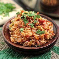 Warm up this winter with a hot bowl of Spicy Vegan Jambalaya, with heart-healthy tomatoes that add a boost of antioxidants and vitamin C. #mardigrasrecipes #healthyrecipes #winterrecipes #everydayhealth | everydayhealth.com