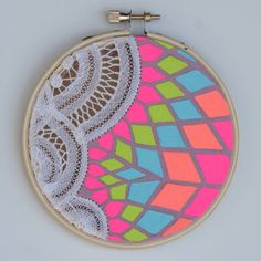 vintage lace napkins painted with neon acrylic paint and framed in an embroidery hoop
