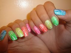 White gloss nails each with a different color of tiger stripes, Rainbow, gay pride, free hand nail art   Best Nail Art Ideas