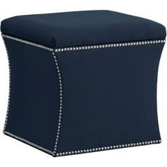 Offer guests an extra seat or rest a tray of expertly mixed cocktails atop this stylish essential, an inviting addition to your living room or master suite.   Product: Storage ottomanConstruction Material: Solid pine, polyurethane and polyester fill foamColor: NavyFeatures:  Curvaceous silhouette is finished with an elegant nailhead trimVersatile function for storage, footrest, or tabletop Handmade in the USA Dimensions: 17 H x 19 W x 19 D