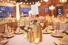 Empty Glass Bottles Fill In As Gorgeous Wedding Centerpieces Wine Bottle Centerpieces, Wedding Table Centerpieces, Reception Decorations, Table Decorations, Centerpiece Ideas, Diy Centrepieces, Reception Table, Empty Glass Bottles, Painted Wine Bottles