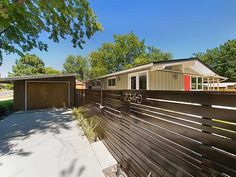 Remodeled modern ranch-style home in Harvey Park: Driveway leading to garage converted into spare bedroom