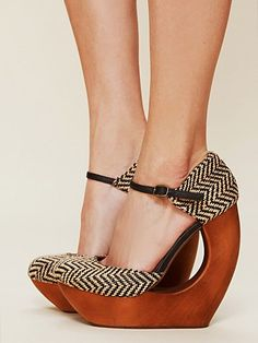 "Rockaway Cutout Wedge | Suede mary-jane style cutout wedge with platform. Wooden bottom. Adjustable ankle strap.  *By Jeffrey Campbell  *Suede Upper, Wood Heel  *Import  *1 1/2"" platform, 5 3/4"" heel"