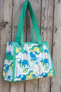 I'm excited to introduce you to the newest pdf sewing pattern to enter my pattern shop, the Park West Bag! This large bag is great for holding a lot of stuff! There are side pockets on the exterior of the bag, and a lining zippered pocket on the inside. With pretty handle detailing for your …