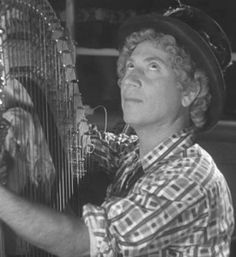 """Harpo Marx,  (later Arthur """"Harpo"""" Marx) (November 23, 1888 – September 28, 1964) was an American comedian and film star. He was the second oldest of the Marx Brothers. His comic style was influenced by clown and pantomime traditions. He wore a curly reddish wig, and never spoke during performances (he blew a horn or whistled to communicate). Marx frequently used props such as a walking stick with a built-in bulb horn, and he played the harp in most of his films."""