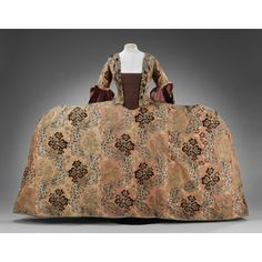 Ca 1760s French made Mantua for English court wear. Made of reddish silk brocaded with multicolored flowers, silver gilt wrapped thread, and with an ermine motif.