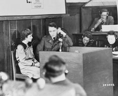 Fifteen-year-old Maria Dolezalova testifies for the prosecution at the RuSHA Trial. She was one of the children kidnapped by the Germans after they destroyed the town of Lidice, Czechoslovakia. Nuremberg, [Bavaria] Germany. October 30, 1947