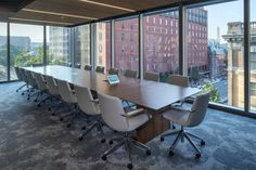 GTM Architects have recently completed the office for global shipping giant, FedEx, located in Washington DC. This particular Washington DC office would Wood Slat Ceiling, Wood Slats, Cloud Ceiling, Black And White Office, Transom Windows, Rectangle Table, Break Room, Neutral Colour Palette, Architect Design
