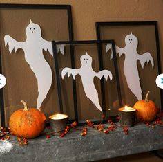 Framed Decoration: Start a ghost gallery with this do-it-yourself art, Find some ghostly Images and print them out, size to  to fit the glass you will be using. Trace onto white paper, mark the eyes and noses with black marker, and cut out the shapes. Sandwich the ghouls between sheets of glass from document frames. Use black fabric tape or book-binding tape (available at crafts stores) to seal the edges. Display on a shelf or mantel with seasonal trims like bittersweet and mini pumpkins.