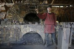 Clement Guerard, blacksmith at the site since 1999, poses in his workshop on October 29, 2013. #