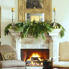 Streamlined Showpiece    Lush fir branches, dotted with green pears, burst from this stone mantel for a look that's simultaneously simple and lavish.