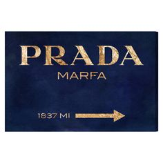 """Oliver Gal's Marfa Navy canvas wall art adorns interiors with fashion-forward flair. A blue and gold piece with the Prada address, this fun accent offers graphic glamour. Fine art canvas print; Professionally hand stretched; Gallery wrapped in 1.5"""" wide, FSC certified wood; Wood used on items larger than 45x30 is 2"""" wide; Ready to hang; Hardware included; Accompanied by a certificate of authenticity; Made in the USA; 24""""W x 16""""H; 30""""W x 20""""H; 36""""W x 24""""H; 45""""W x 30""""H; 60""""W x 40""""H"""