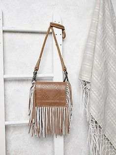Foreverly Bag | Perfectly sized with tons of charm! This petite embossed leather bag features carnival colored suede fringe, black and white geo tapestry sides, and a thick rope shoulder strap. For the wild heart. Envelope style with magnetic snap button closure.   *By Free People