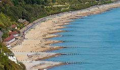 Eastbourne Beach in East Sussex, England showing sea defence groynes