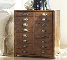 Love this side table. Look at all those drawers!