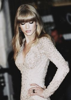 Taylor Swift looking elegant in pale glitter -MH #stylishstars love her, her hair, and that dress (: