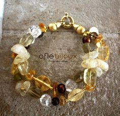 Wonderful bracelet made of citrine, cristals, sweet water pearls, Akan gold weight.