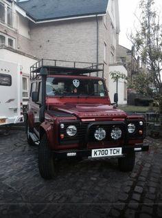Burgundy Land Rover Defender