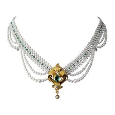 Unique Draped Pearl Necklace with Emerald Centerpiece