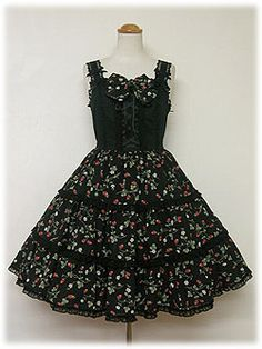 Brand:  Angelic Pretty Product Number:  72J2-2251 Item Type:  JSK Price:  ¥24,990 Year:  2007 Colors:  Black, Pink, Sax, White Features:  Lining, Partial shirring, Corset lacing, High waist, Adjustable straps, Detachable bow, Detachable waist ties, Side zip, Tiered skirt Other notes:  ♥Material♥ •Body: Polkadot karami (100% cotton) •Additional Fabric: strawberry chiffon (100% polyester)  ♥Lace♥ •Chemical lace •Tulle lace  ♥Other♥ •Satin ribbon •Partial shirring offers limited ease of…