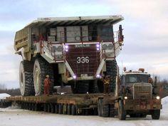 Peterbilt moving the huge Terex rear dump.