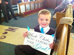 My husbands nephew our sign bearer. Wedding day