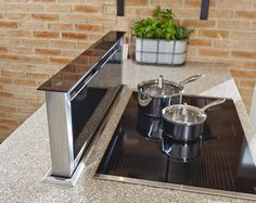 Disguise your extractor fan with a pop-up appliance that's effective and sophisticated. Curved Kitchen Island, Kitchen Island With Cooktop, Kitchen Island Dimensions, Kitchen Island With Stove, Contemporary Kitchen Island, Industrial Kitchen Island, Kitchen Island Makeover, Kitchen Island Decor, Kitchen Corner