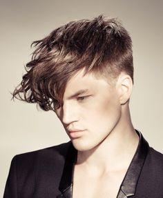 Shaved Sides with a Long Curly Top on Haircuts for Men