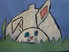 These bunnies hiding in the grass by the first graders are adorable!  We painted the bunnies and colored the details with construction paper crayons. The kids loved making that one floppy ear!  Great geometric and organic shape lesson!: