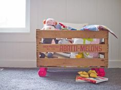 Keep toys and books safely tucked away in a fruit crate. All you need are a few materials: casters, spray paint, spare wood and the crate itself. (http://www.hgtv.com/handmade/genius-toy-storage-solutions-you-can-make/pictures/index.html?soc=pinterest)