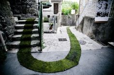 Gaëlle Villedary's Tapis Rouge. 1,400 feet of turf grass rollers installed through the streets of Jaujac, France.