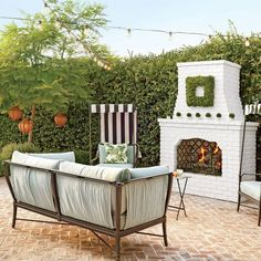 herringbone brick with white painted fireplace: House of Turquoise: Waterleaf Interiors