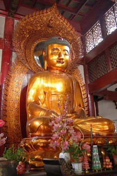 One of the Three Golden Buddhas at Six Banyan Temple in Guangzhou, China - (Photo © Withoutink)