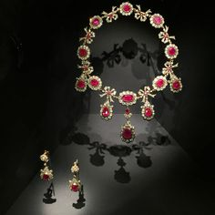 A ruby and diamond parure that Post acquired in 1966 that might have previously belonged to Eugenia Maximilianova, Duchess of Oldenburg. Designed as a series of diamond and ruby clusters supporting a fringe of round and oval-shaped rubies, the necklace could have dated back to the First Empires.