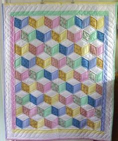 Tumbling Blocks - what an appropriate pattern for a baby quilt!