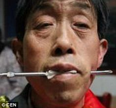 Custom: Two men join in the ancient tradition of face-piercing which has been going on for thousands of years innorthern China's Shanxi province