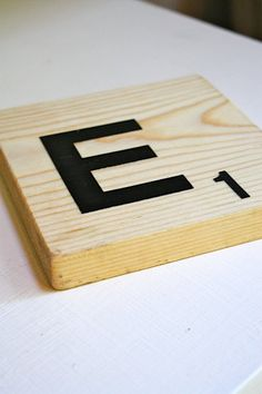 Who doesn't have a scrap piece of wood around the house...Large letter E oversized scrabble tile. Makin it!