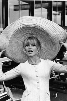 MAY 1965 – When she arrived back in France following filming of Viva Maria, a Western that also starred Jeanne Moreau, she emerged wearing a huge sombrero that she had bought on location in Mexico. Photo By PA Photos