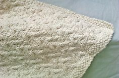 I wanted to create a timeless, creamy baby blanket in a simple cable pattern that would be perfect for a baby girl or boy. The organic cott...