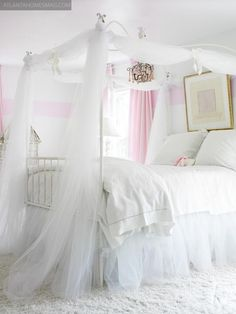 .White and pink striped walls, white canopybed, would like to see a few pink accents