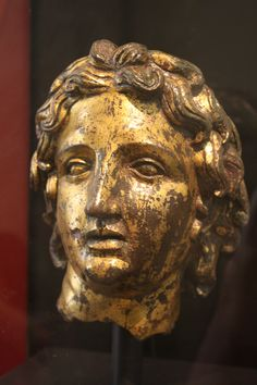 Head of Alexander the Great from a smaller than life-size statue, goldleaf on bronze, 2nd century CE. (Palazzo Massimo, Rome).   http://www.ancient.eu.com/image/1238/