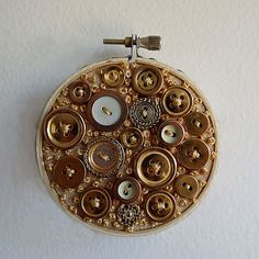 Glittering Golden Button Embroidery Hoop by TheChestOfDrawers on Etsy. I want a bunch of these in diff shapes and sizes to hang above my bed!