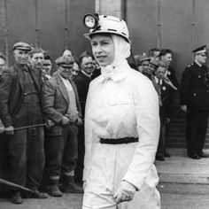 The Queen is seen here during her visit to Rothes Colliery, Fifeshire, it was her first visit to a coal mine and she spent about half an hour underground visiting the coal face.