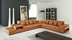 Modern camel and brown sectional sofa features a durable long-lasting construction. Perfect for Movie time!
