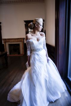 Melissa Gentile Fall 2015 couture bridal collection style # Versailles. lace wedding dress. French lace bridal gown. couture bridal gown. a-line wedding dress. lace ball gown. silk organza. romantic layers. ruffles. corset lace bodice.   www.melissagentile.com