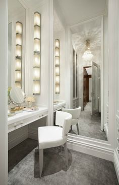 Dream makeup room. I love the modern approach to makeup lighting.