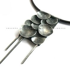 £231.00  Pendant made of silver 925, hang on leather strap. Pendant dimension - 11 cm, circumference  - 48cm