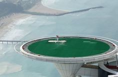 Rory McIlroy plays a bunker shot on the helipad at the Burj Al Arab hotel in Dubai. Photograph: David Cannon/Getty Images